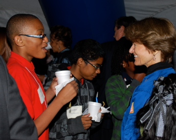 A student chatting with Sally Ride